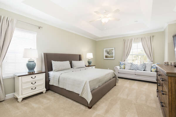 The master suite is spacious and bright with a king bed