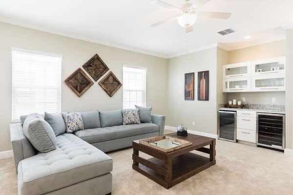 Head upstairs to relax in the loft area, complete with a wet bar for enjoying a beverage