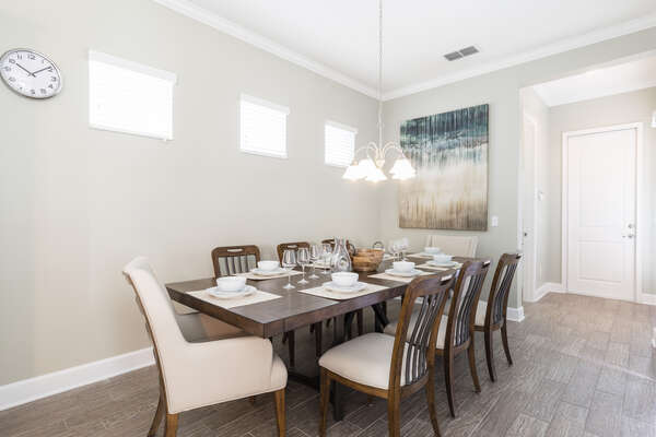 The formal dining space is perfect for everyone to sit down and enjoy meals together