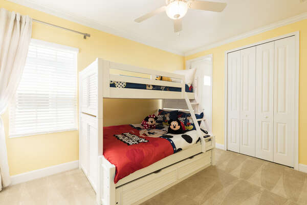 Kids will love this fun bedroom with a Twin/Full bunk bed and twin trundle