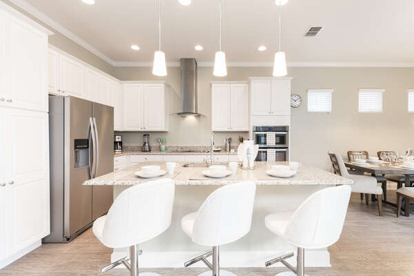 Have a quick meal or snack at the breakfast bar with seating for 3