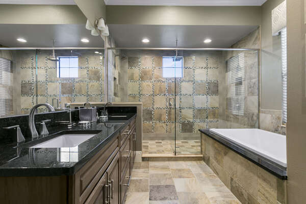 Large ensuite bathroom with bathtub and walk-in shower