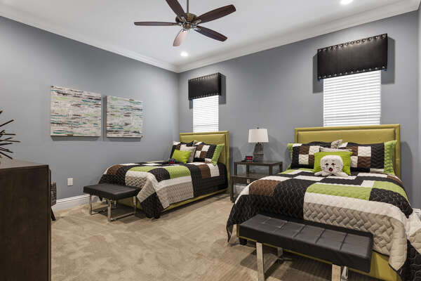 This bedroom is fun for gamers with two full beds and video game accents