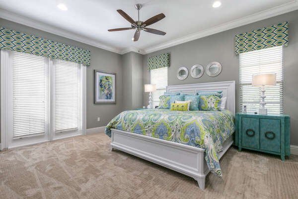 Master Suite #6 is located on the second floor with vibrant blue and green accents and balcony access