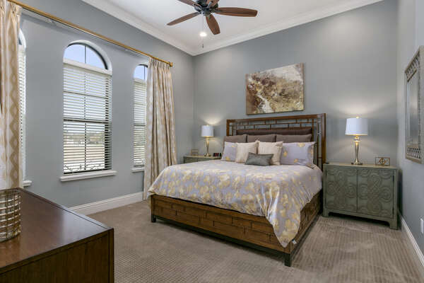 Master Suite #3 with a plush king bed and beautiful design accents located on the first floor
