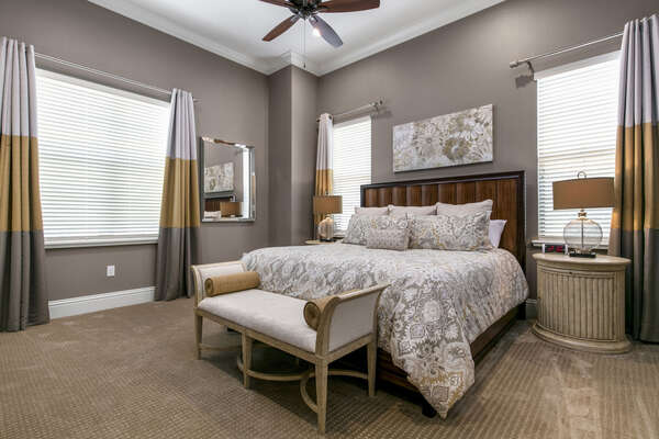 The first Master Suite is located downstairs and features a comfortable King bed
