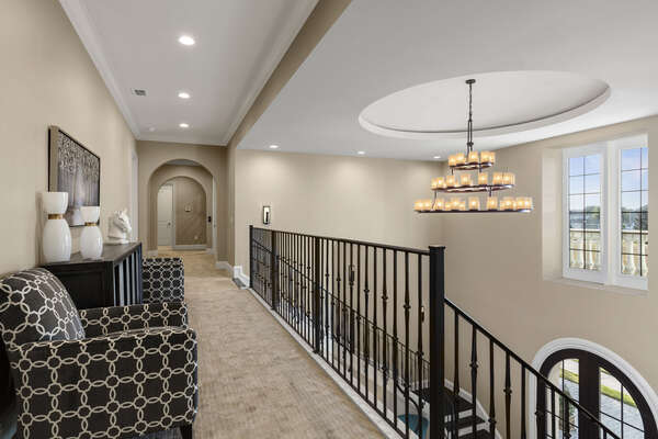 Head upstairs on the double staircase to even more luxury located on the second floor