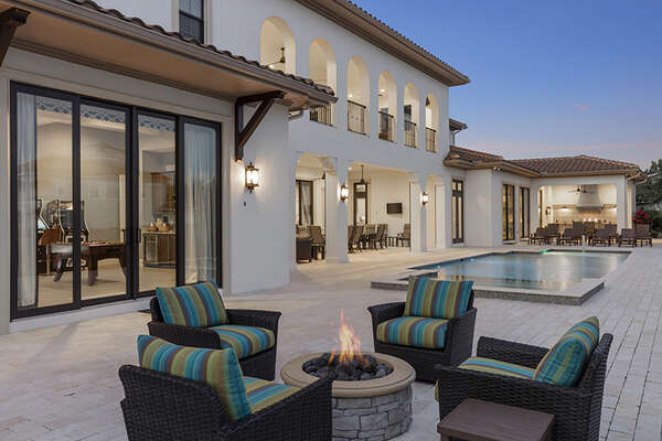 Chill by the fire pit and enjoy the gorgeous Florida weather