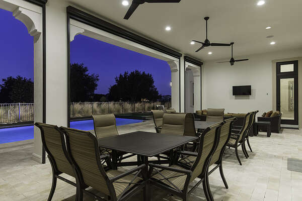 Sit underneath the covered lanai and enjoy a meal with seating for 12