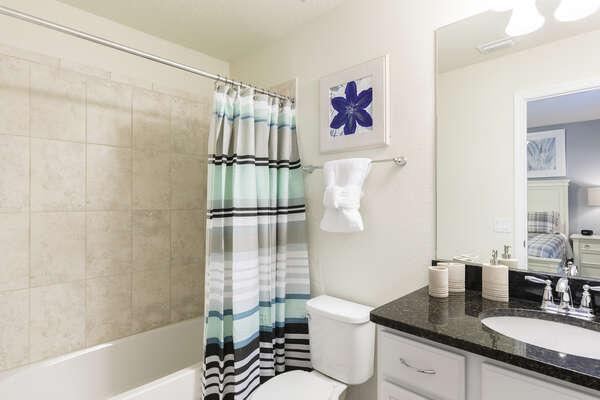 Ensuite bathroom with combination shower/bathtub