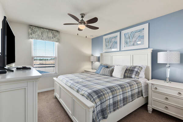 Upstairs bedroom with a king-size bed