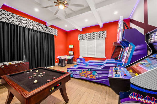 This fun game room features plenty of entertainment and access to the back pool area