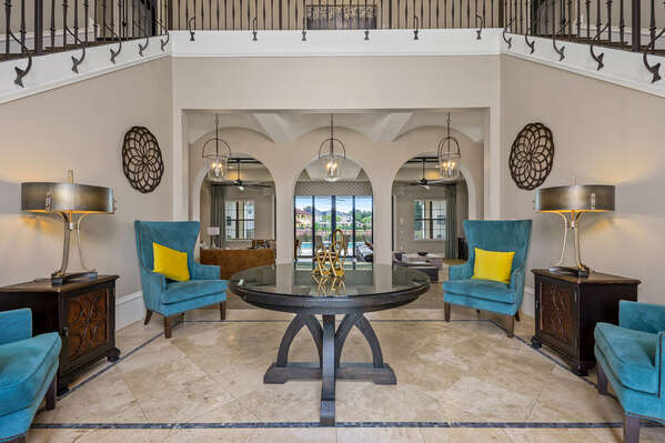 This elegant foyer invites you into the home