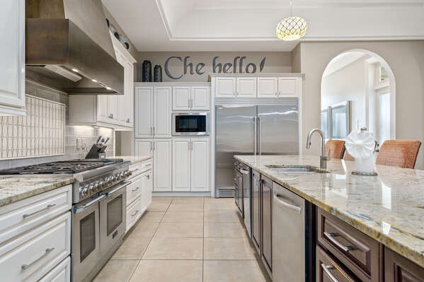 This fully equipped kitchen features stainless steel appliances and granite countertops