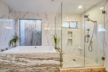 Roman Soaking Tub and a Dual-Head Shower