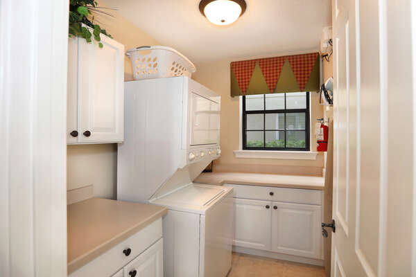 Fully equipped laundry room with a washer and dryer