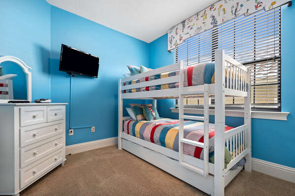 Kids will love picking their bunk in this twin/twin bedroom