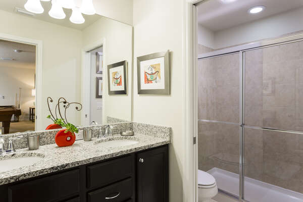 Family bathroom located on the second floor with a walk-in shower