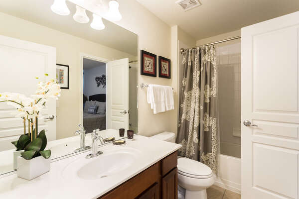 Private bathroom with a combination shower/bathtub