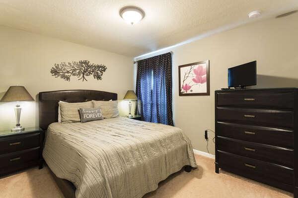 Sleep comfortably in this cozy queen bedroom