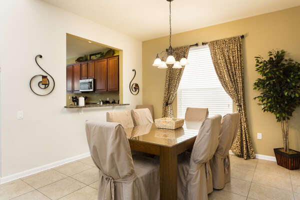 A formal dining room with seating for 6