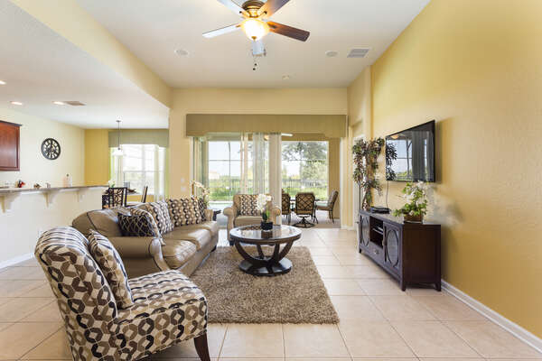 Spacious living area with comfortable seating and TV to catch up with your favorite shows