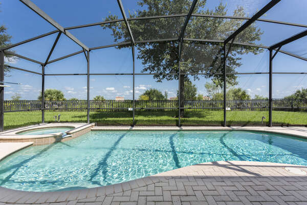 Your own screened-in private pool with spillover spa to enjoy