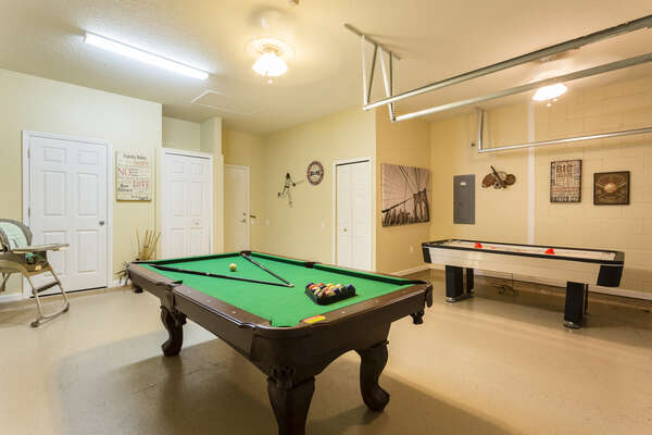 Fun private games room with a pool table and air hockey table