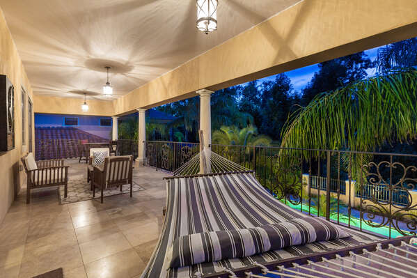 Relax on the hammock or comfortable patio furniture