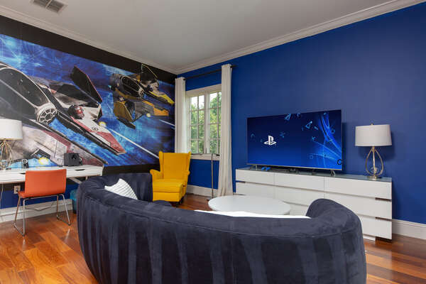 Kids have their own couch and TV area connected to a PS4