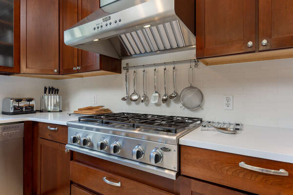 Stainless steel appliances and dark wood cabinets
