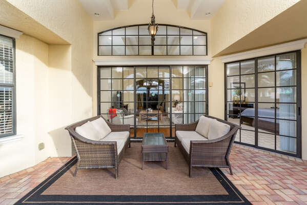Relax underneath the covered lanai on plush patio furniture