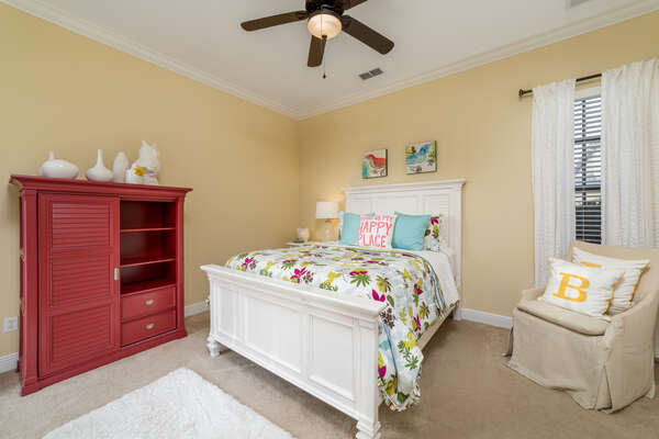 This queen bedroom features beautiful bright colors