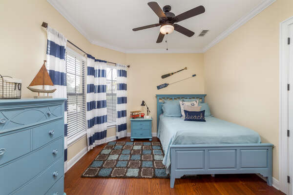 Kids will love to stay in this bedroom featuring a full bed