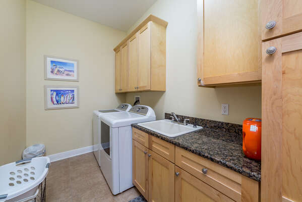 The home is equipped with a washer and dryer in the laundry room