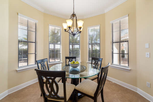 The informal dining nook has seating for 5 for quick meals