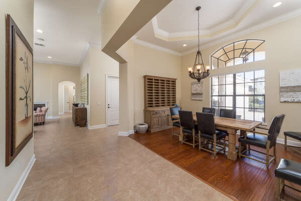The formal dining room table is a great place to sit down and enjoy a meal