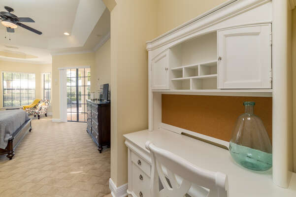 The spacious master suite has a desk and seating area