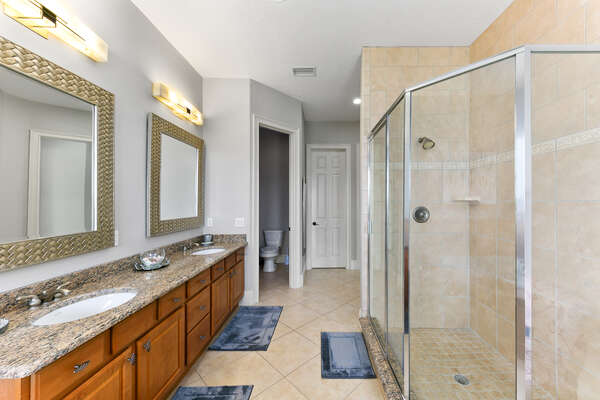 With a tub and walk-in shower