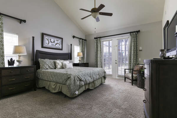This downstairs king bedroom is the erfect place to come home to and relax