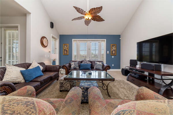 Open living room area with plenty of plush seating for everyone