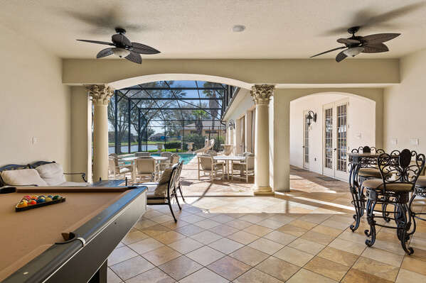The pool area comes complete with a bar, Tv and pool table