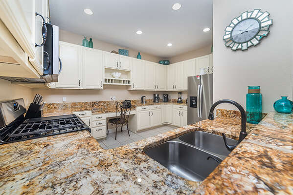 The kitchen is fully equipped with stainless steel appliances