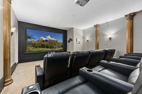 The movie theatre has a 100-inch screen, surround sound style, and stadium-style seating