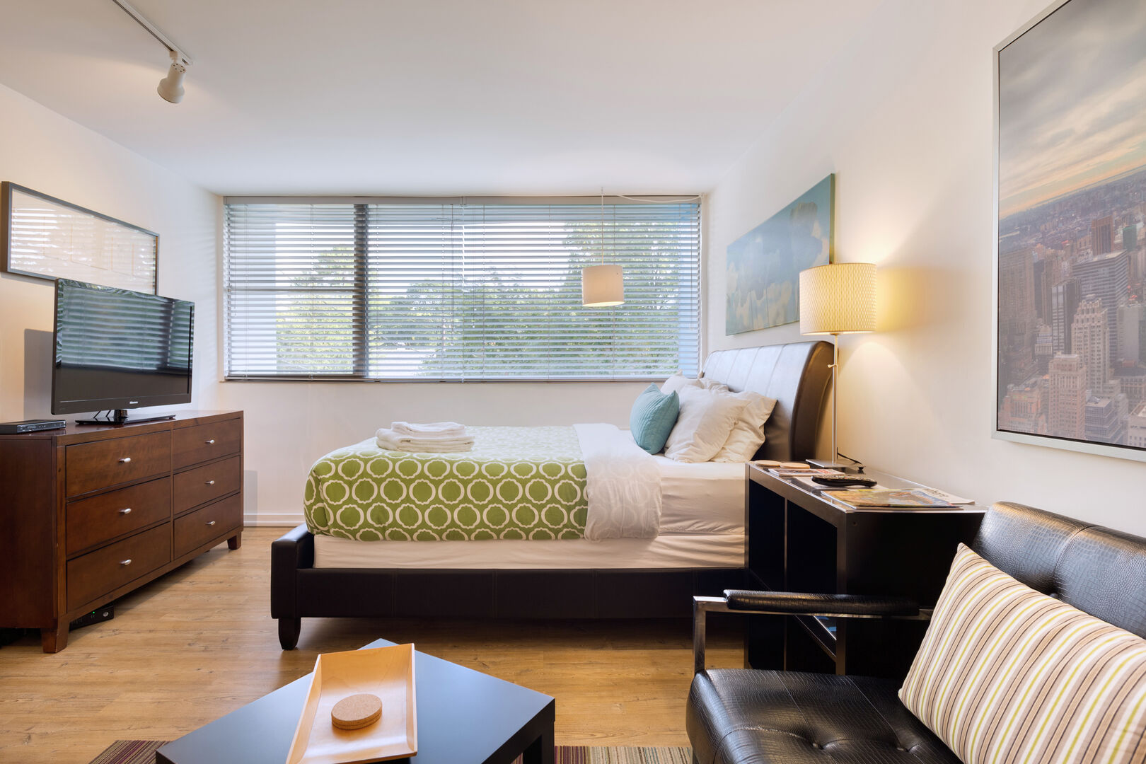 Furnished Living Room and Bedroom - Corporate Apartments - Chic Premium Studios On 25th