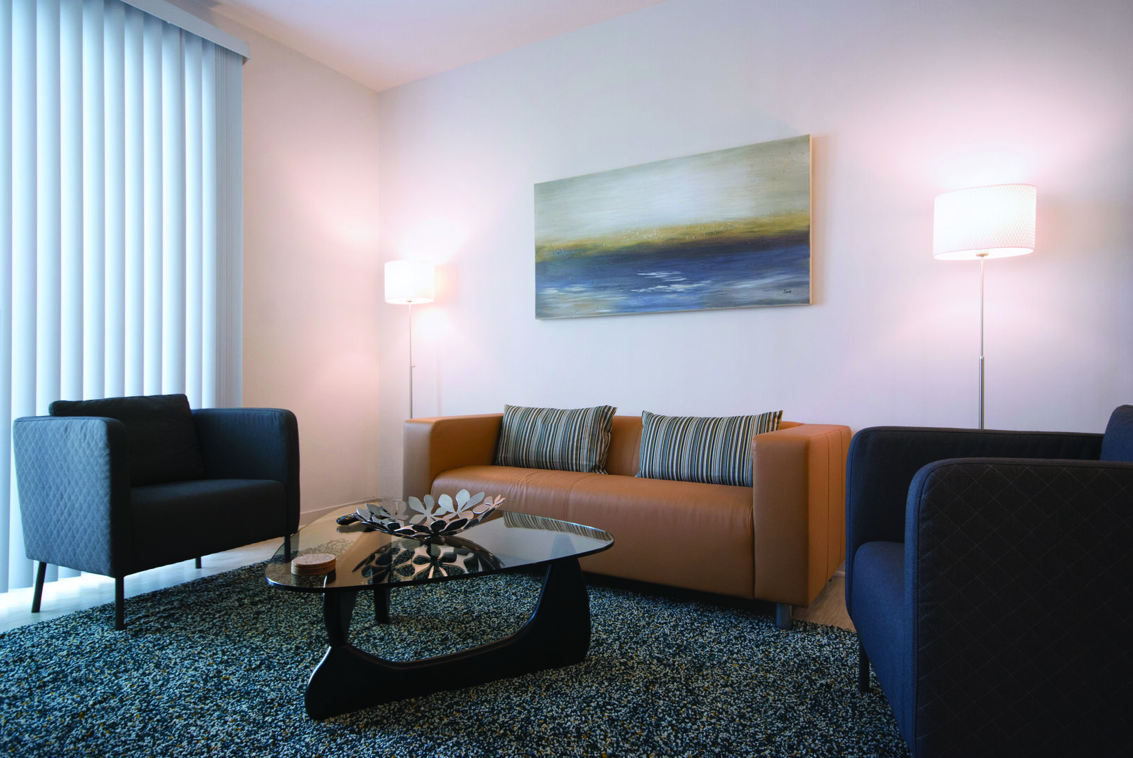 Furnished Living Room with Modern Interior Design - Corporate Apartments - 1-Bedroom Spectacular Suites
