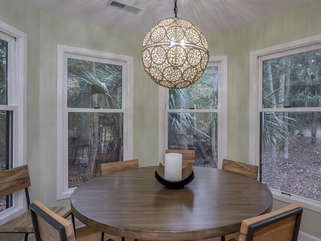 Dining room seating for 8 with beautiful windows and views