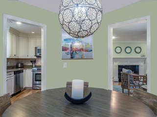 Dining area opens to kitchen and living areas