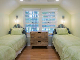 Guest bedroom on second floor with 4 twin beds