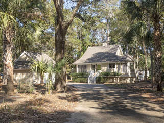 Private, wooded setting with golf course views